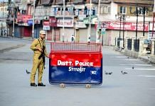 A policeman stands alert near a check point in Srinagar | Saqib Majeed/SOPA Images/LightRocket via Getty Images