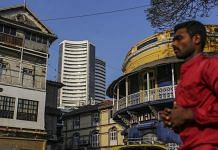 Pedestrians walk past the Bombay Stock Exchange (BSE) building | Dhiraj Singh/Bloomberg