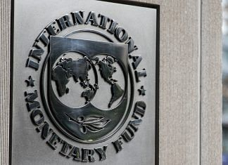 Signage is displayed outside the IMF | Alex Wroblewski/Bloomberg