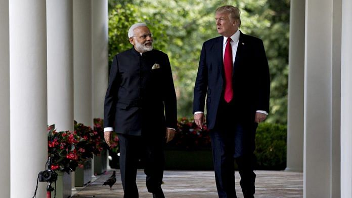 Narendra Modi and Donald Trump | Andrew Harrer/Bloomberg