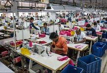 Employees operate sewing machines at a garment factory in Kolkata | Taylor Weidman/Bloomberg