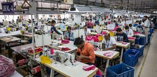 Employees operate sewing machines at a garment factory in Kolkata   Taylor Weidman/Bloomberg