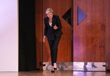 U.K. prime minister Theresa May dances onto the stage at the Conservative Party annual conference in Birmingham, U.K.   Chris Ratcliffe/Bloomberg