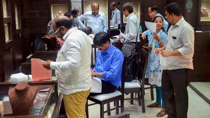 An ED team raiding the Viviana Mall in Thane   PTI photo