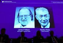 The scientists' images displayed on a screen   Jonathan Nackstrand/AFP/Getty Images