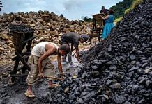 Daily wage laborers shovel coal into baskets at a limestone quarry in Lower Cherrapunji in Meghalaya| Sanjit Das/Bloomberg