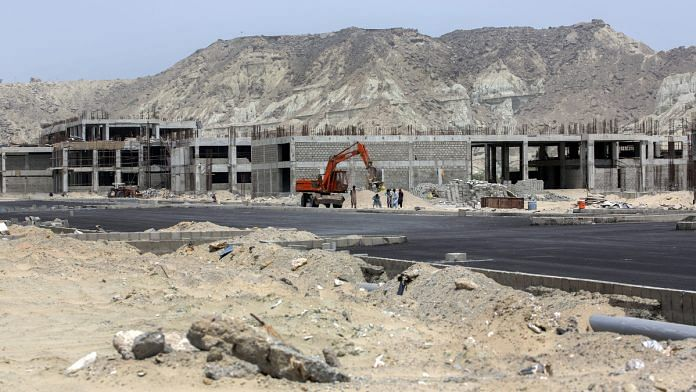 Buildings stand under construction at a development site, operated by China Overseas Ports Holding Co., near Gwadar Port in Gwadar, Balochistan, Pakistan | Photographer: Asim Hafeez/Bloomberg