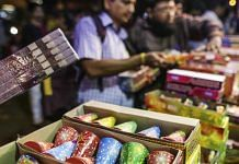 Customers shop for firecrackers and fireworks at a stall during Diwali | Dhiraj Singh/Bloomberg