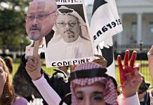 Protesters hold photographs of journalist Jamal Khashoggi outside the White House in Washington, D.C.|