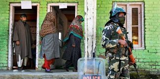 Security personnel guard a polling station in Kashmir | S. Irfan/PTI