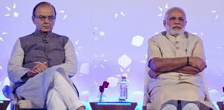 Arun Jaitley and Narendra Modi at a conference in New Delhi | Kuni Takahashi/Bloomberg