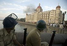 Police personnel outside the Taj Mahal Hotel during the siege by terrorists in Mumbai, on 25 November 2008 | Prashanth Vishwanathan/Bloomberg