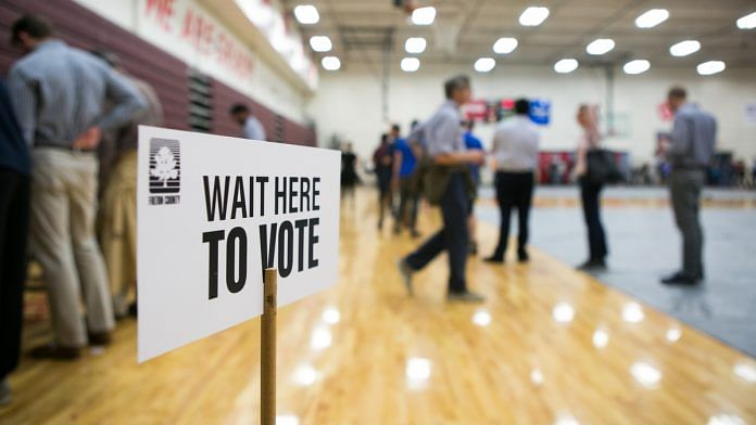 Voters line up to cast their ballots at a polling station set up in Atlanta, Georgia | Jessica McGowan/Getty Images