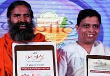 File photo of Baba Ramdev and Acharya Balkrishna | Money Sharma/AFP/Getty Images
