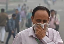 A pedestrian covers his face with a handkerchief for protection against air pollution in New Delhi   Shahbaz Khan/PTI