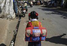 A girl goes to school | Dhiraj Singh/Bloomberg