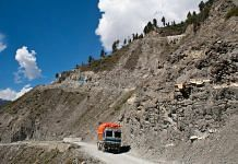 A truck carries supplies to Ladakh on a treacherous road of Zojila Pass