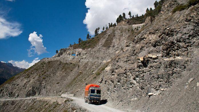 A truck carries supplies to Ladakh on a treacherous road of Zojila Pass