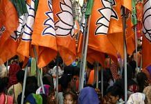 Supporters of BJP carry flags during a rally in Bhopal