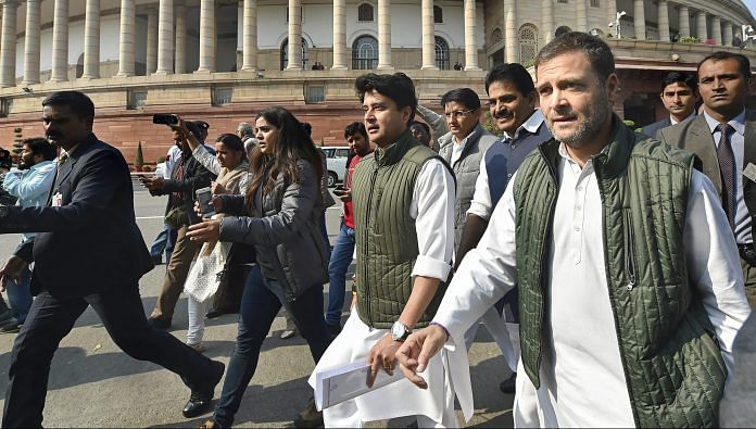 Congress President Rahul Gandhi with party MP Jyotiraditya Scindia during the Winter Session of Parliament