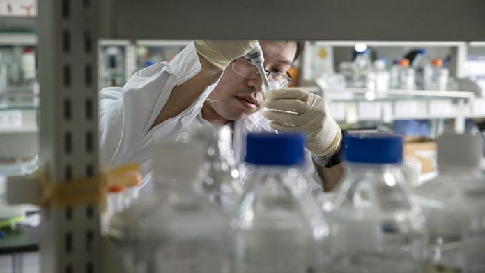 A researcher prepares a sample inside a laboratory in China |
