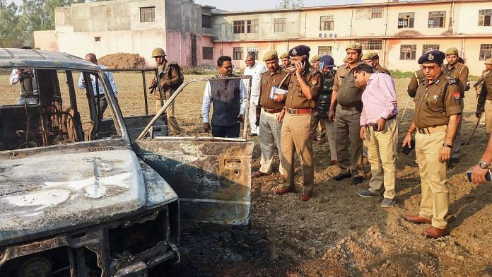 Policemen inspect after several vehicles were set on fire by a mob in Bulandshahr | PTI
