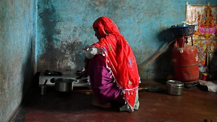 A woman in Uttar Pradesh cooks on a LPG-connected stove | Anindito Mukherjee/Bloomberg