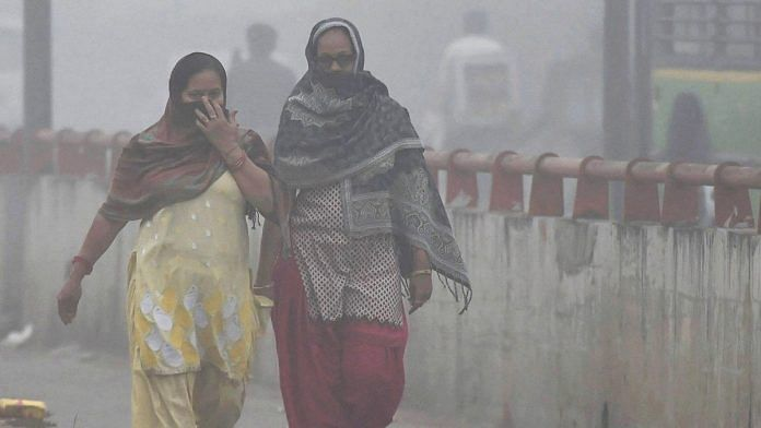 Women try to protect themselves from heavy smog and air pollution   PTI