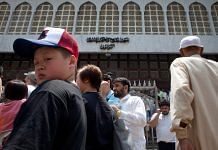 Some tourists and members of Hong Kong's Muslim community outside the Kowloon Mosque and Islamic Center in Tsim Sha Tsui, Hong Kong