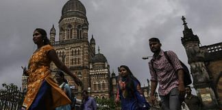 Commuters and pedestrians walk past the Chhatrapati Shivaji Terminus railway station in Mumbai (Representational image)
