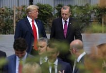 US President Donald Trump, left, walks with Recep Tayyip Erdogan, Turkey's president