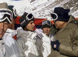 In this Nov 18, 2001 file photo, then defence minister George Fernandes interacts with the jawans at Siachen | PTI