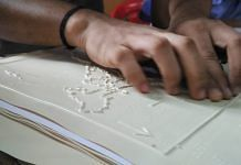A visually impaired student studying a tactile graphic   By special arrangement