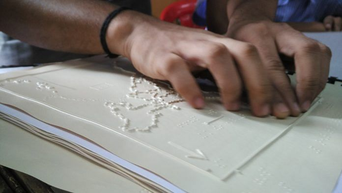 A visually impaired student studying a tactile graphic | By special arrangement