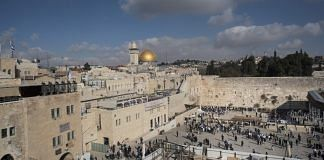 The Western Wall with the Dome of the Rock visible on the skyline in Jerusalem | Hope Ghelli/Bloomberg