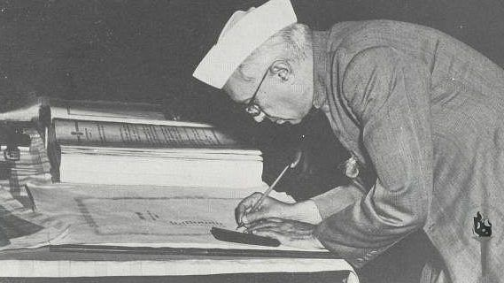 Jawaharlal Nehru signing the Constitution of India | Commons