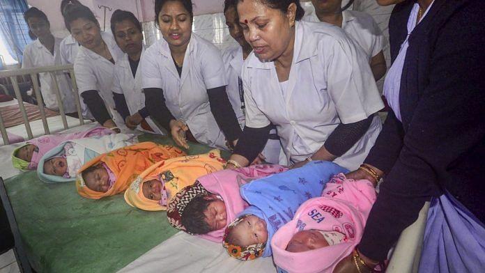 Nurses hold babies   PTI