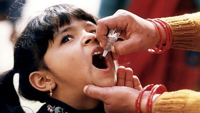 A child receives an oral Polio vaccine | Flickr