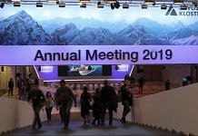 Visitors and workers walk inside the Congress Center ahead of the World Economic Forum in Davos | Simon Dawson/Bloomberg