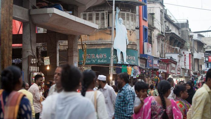 A cut-out of Indian Prime Minister Narendra Modi, center in the middle of a street in Surat (Representational image)