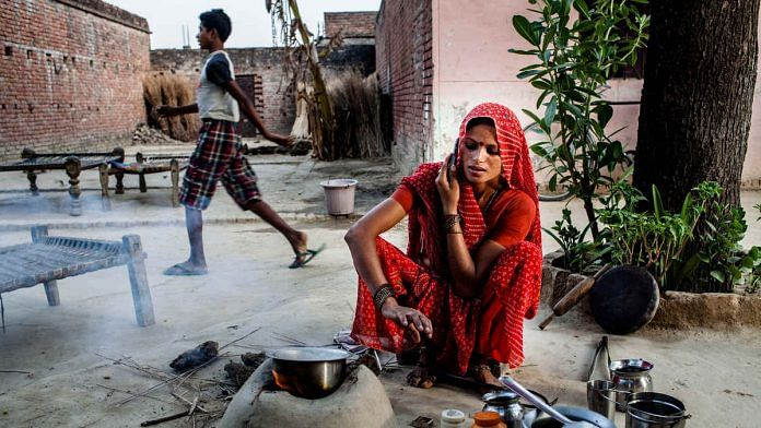 A woman speaks on the telephone in Auwar Village in Pratapgarh district of Uttar Pradesh (Representational image)
