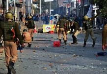Police and CRPF personnel in action against stone-pelting protesters