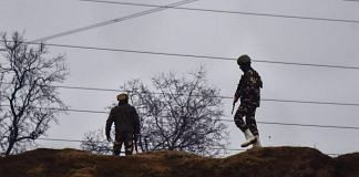 Army soldiers guard near the site of suicide bomb attack at Lathepora Awantipora in Pulwama