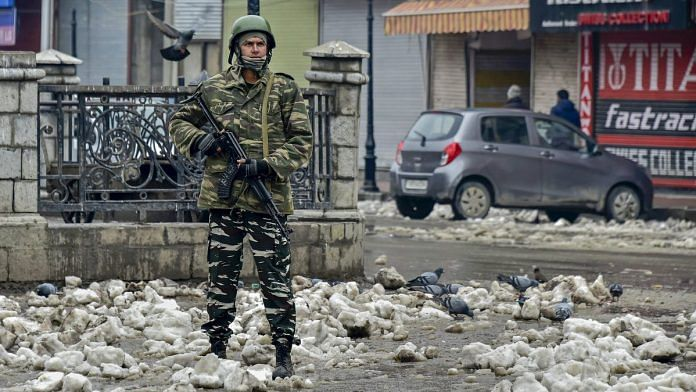 A security personnel stands guard at Lal Chowk | PTI
