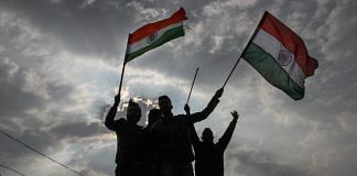 Protestors holding Tricolor raise slogans during a demonstration against the Pulwama terror attack