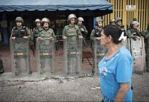A pedestrian passes by Venezuelan army officers (representational image) | Carlos Becerra/Bloomberg