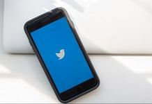 Twitter logo displayed on a phone | Alex Flynn/Bloomberg