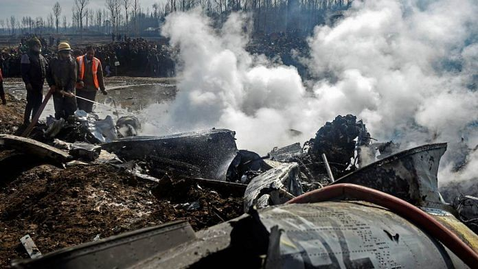 Fire fighters douse flames at the site where an MI-17 chopper of the IAF crashed in Budgam