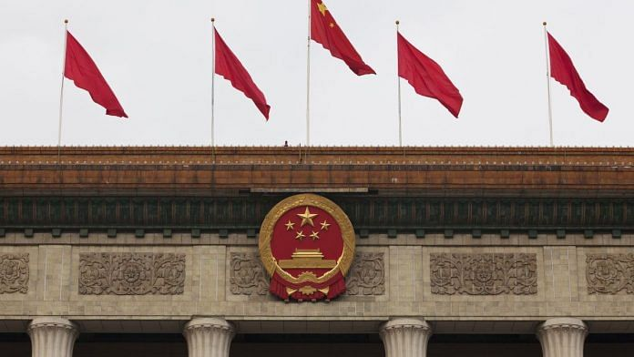 The Chinese national emblem and flags are displayed above the Great Hall of the People in Beijing, China (representational image)   Photo: Giulia Marchi   Bloomberg