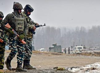 Security personnel inspect the site of suicide bomb attack at Lethpora area, in Pulwama, Friday | PTI